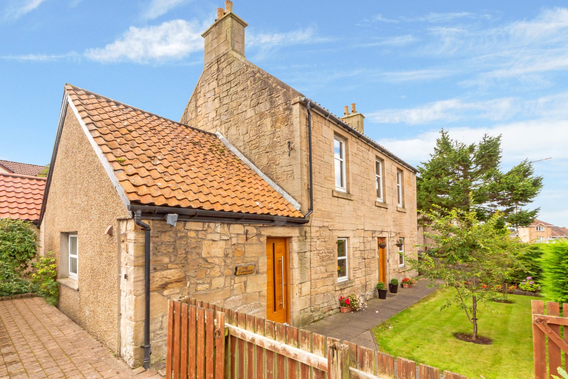 blonde sandstone mid-victorian farmhouse in village