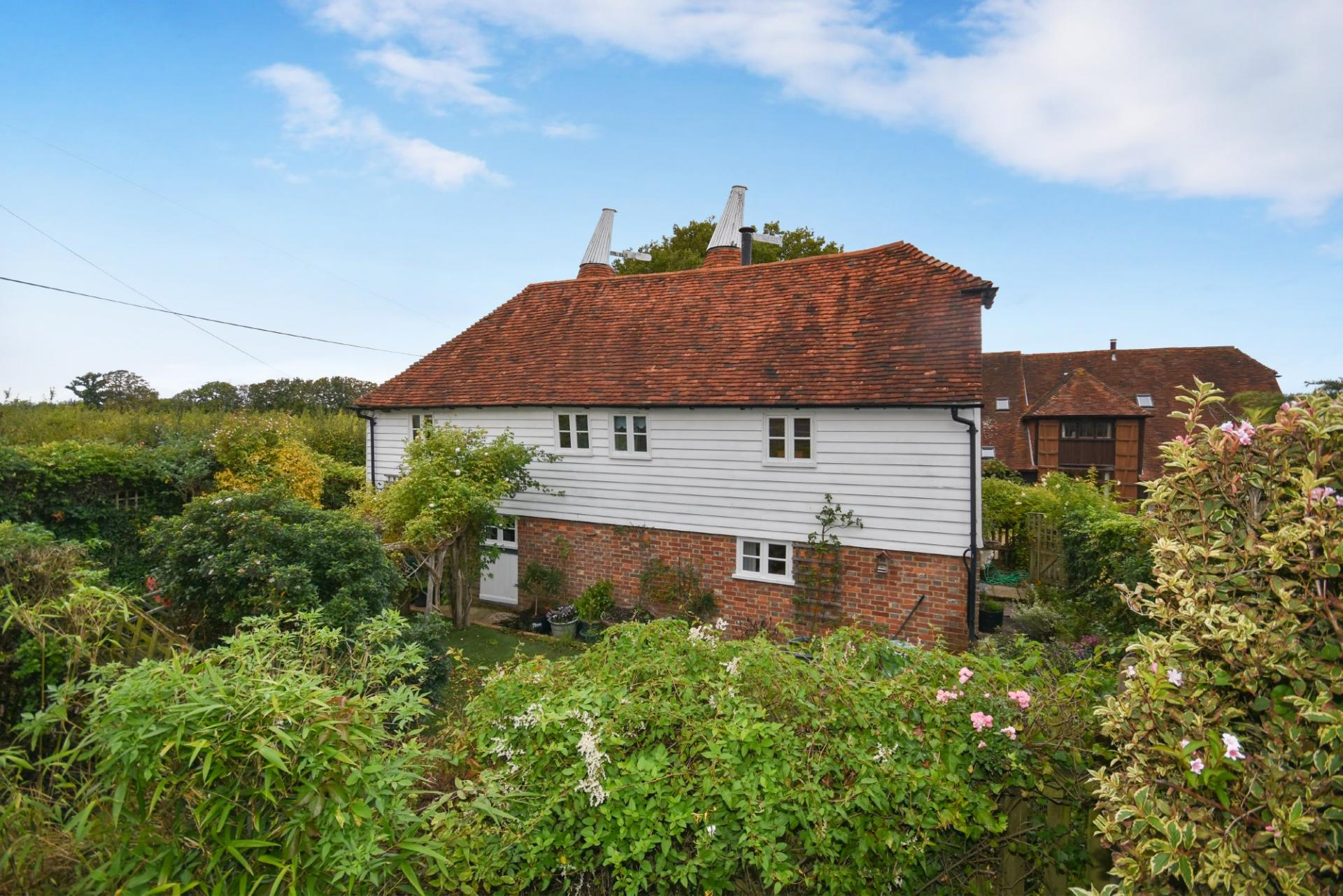 charming renovated converted oast house with white cladding