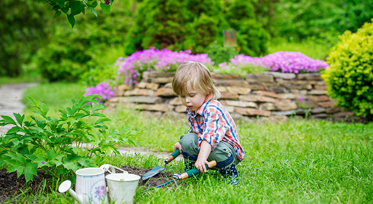 child_son_playing_garden_bucket_trowel_gardening