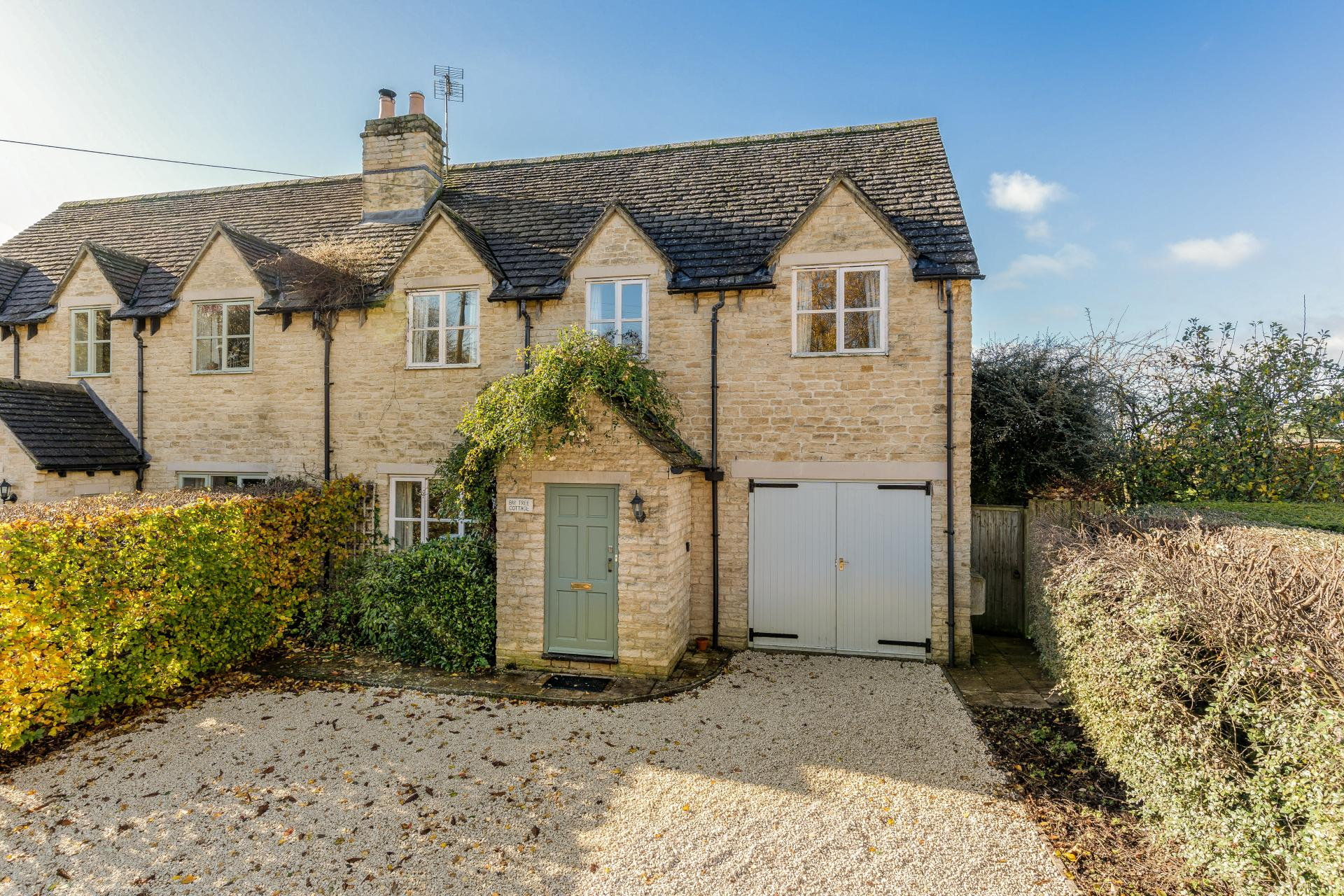 gloucestershire costwolds stone house with sage green door