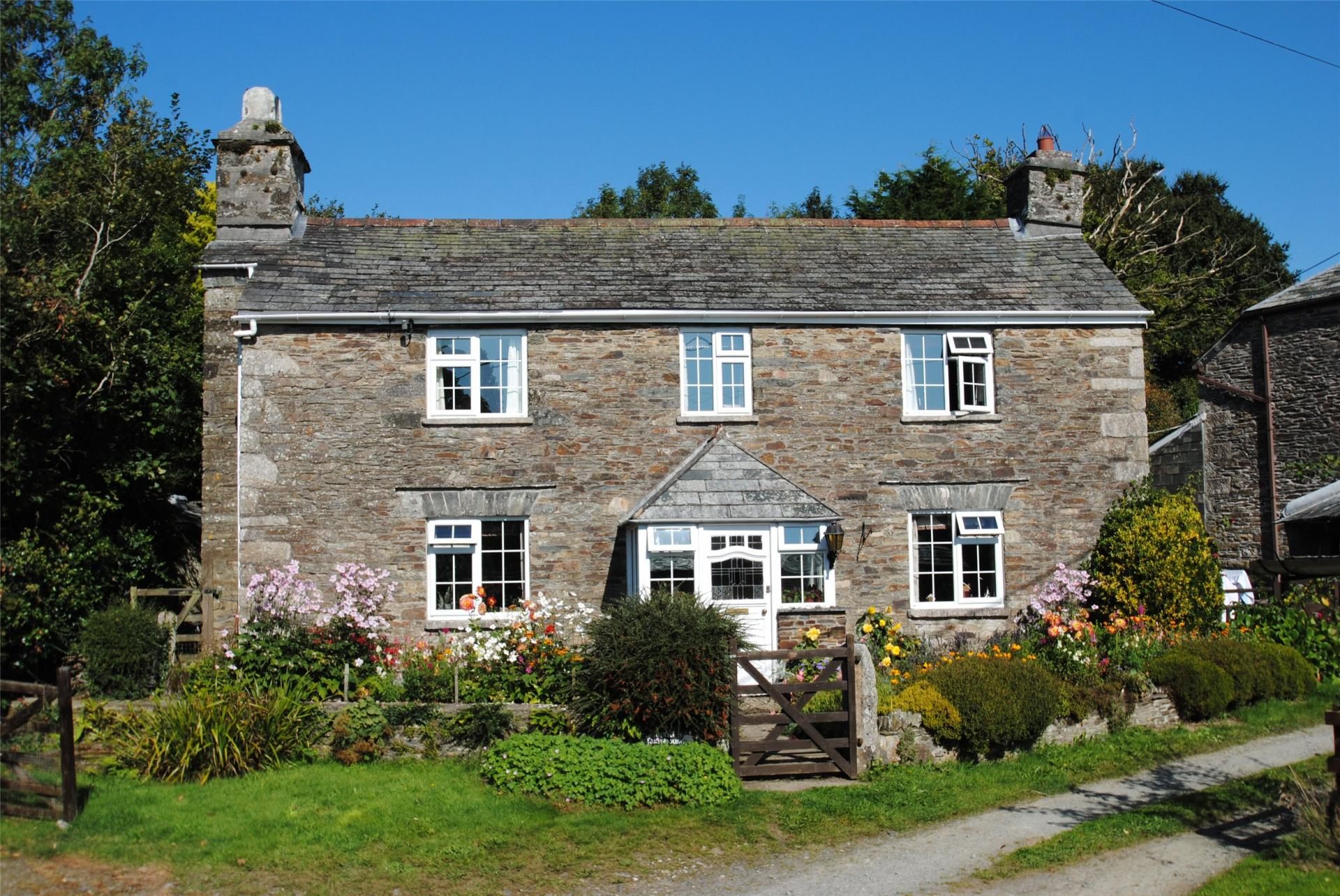 Grade II Listed former farmhouse pretty English country home