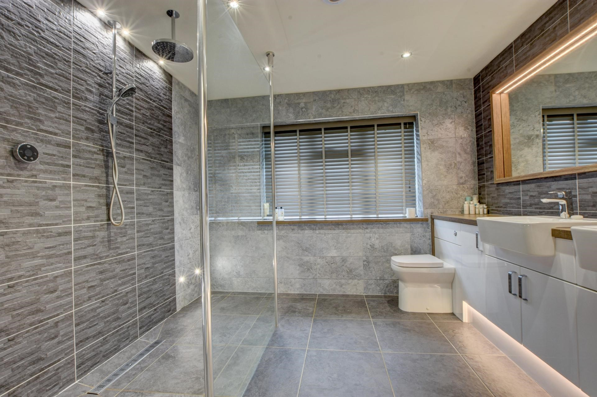 modern contemporary luxury bathroom grey tiles accent lighting