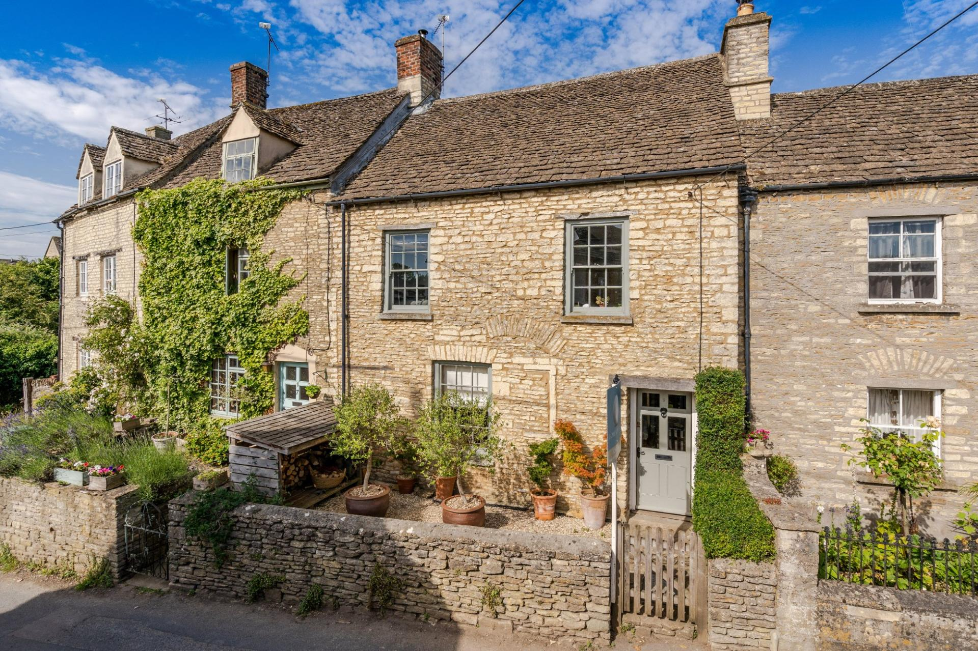 pretty terraced Cotswold stone cottage in Sherston