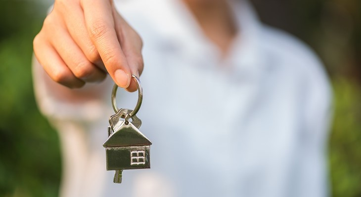 real estate agent keys to new house for buyer