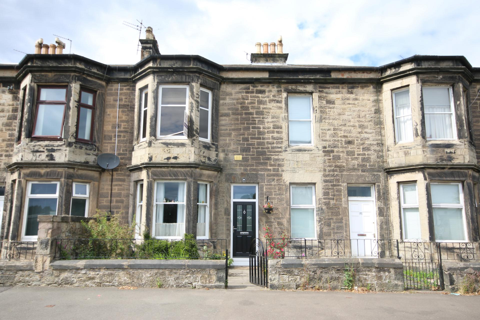 traditional grey sandstone Victorian terraced house with bay window Scotland