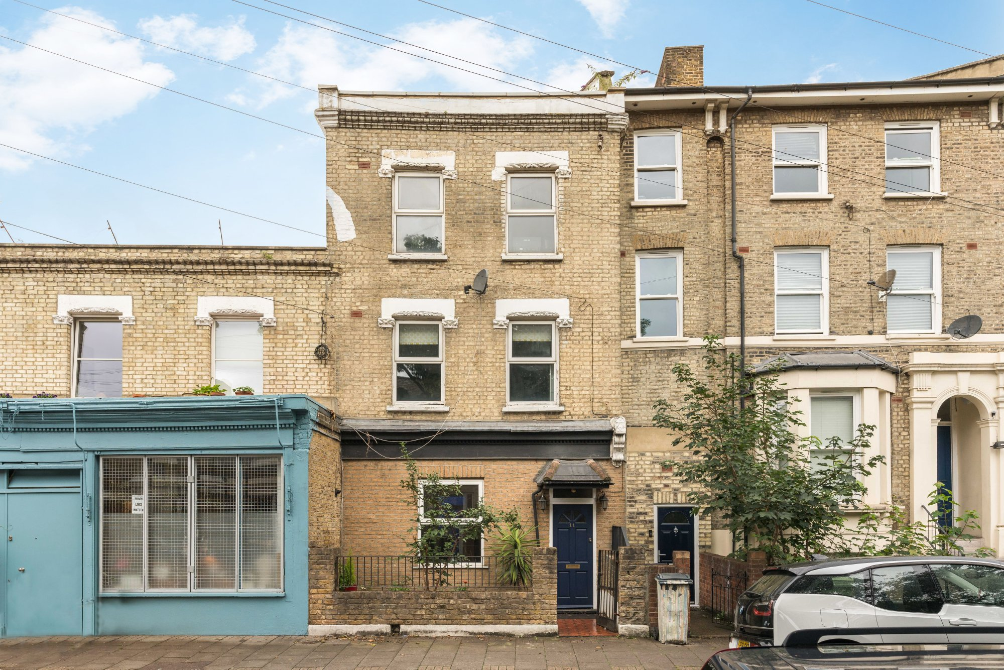 traditional light brick London terraced house