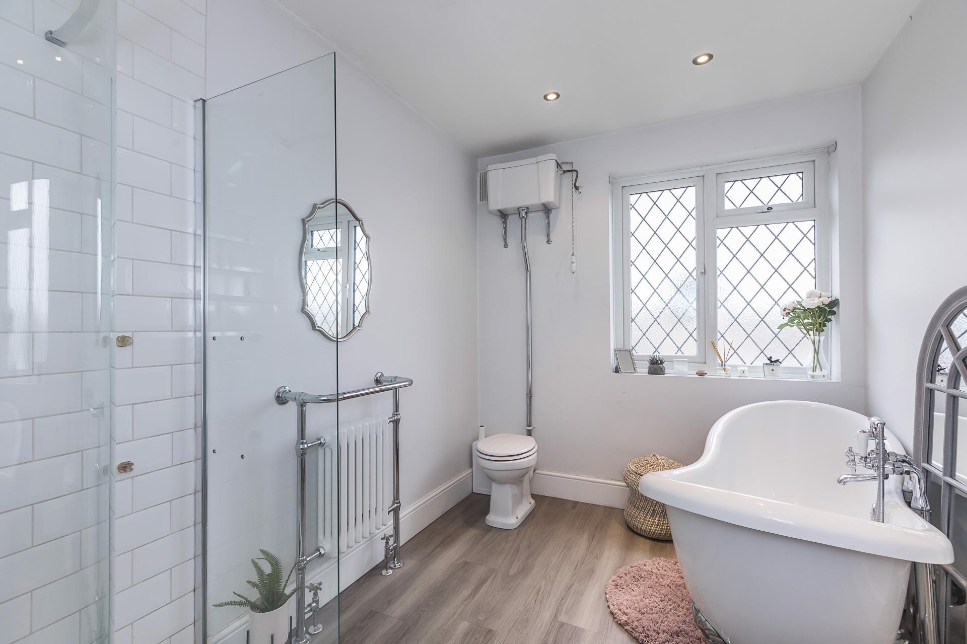 Tudor house simple bathroom renovation oak flooring metro tiles