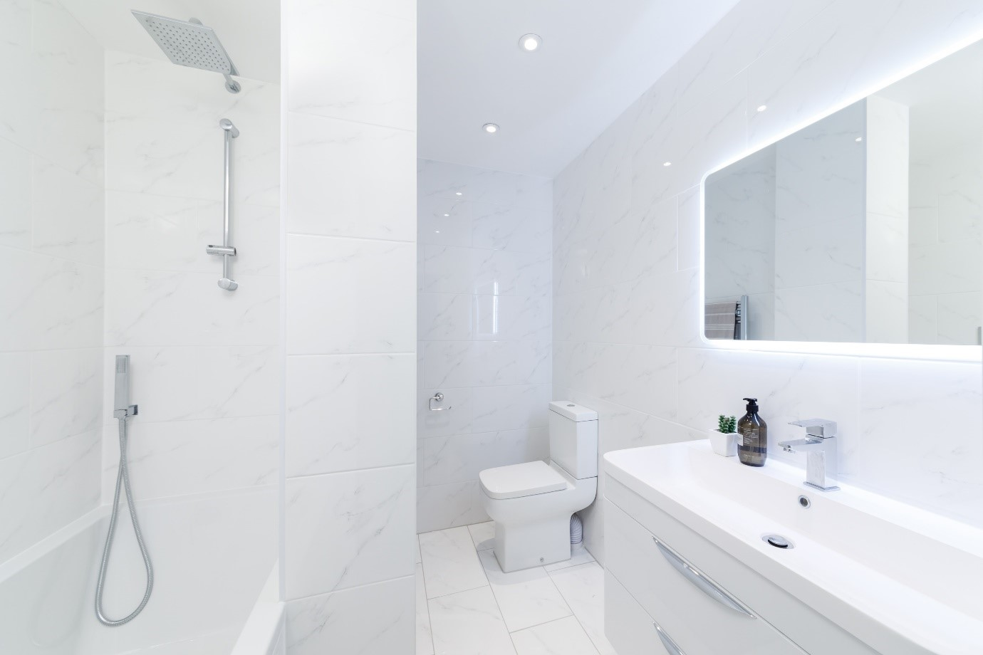 white carrara marble tile modern bright bathroom