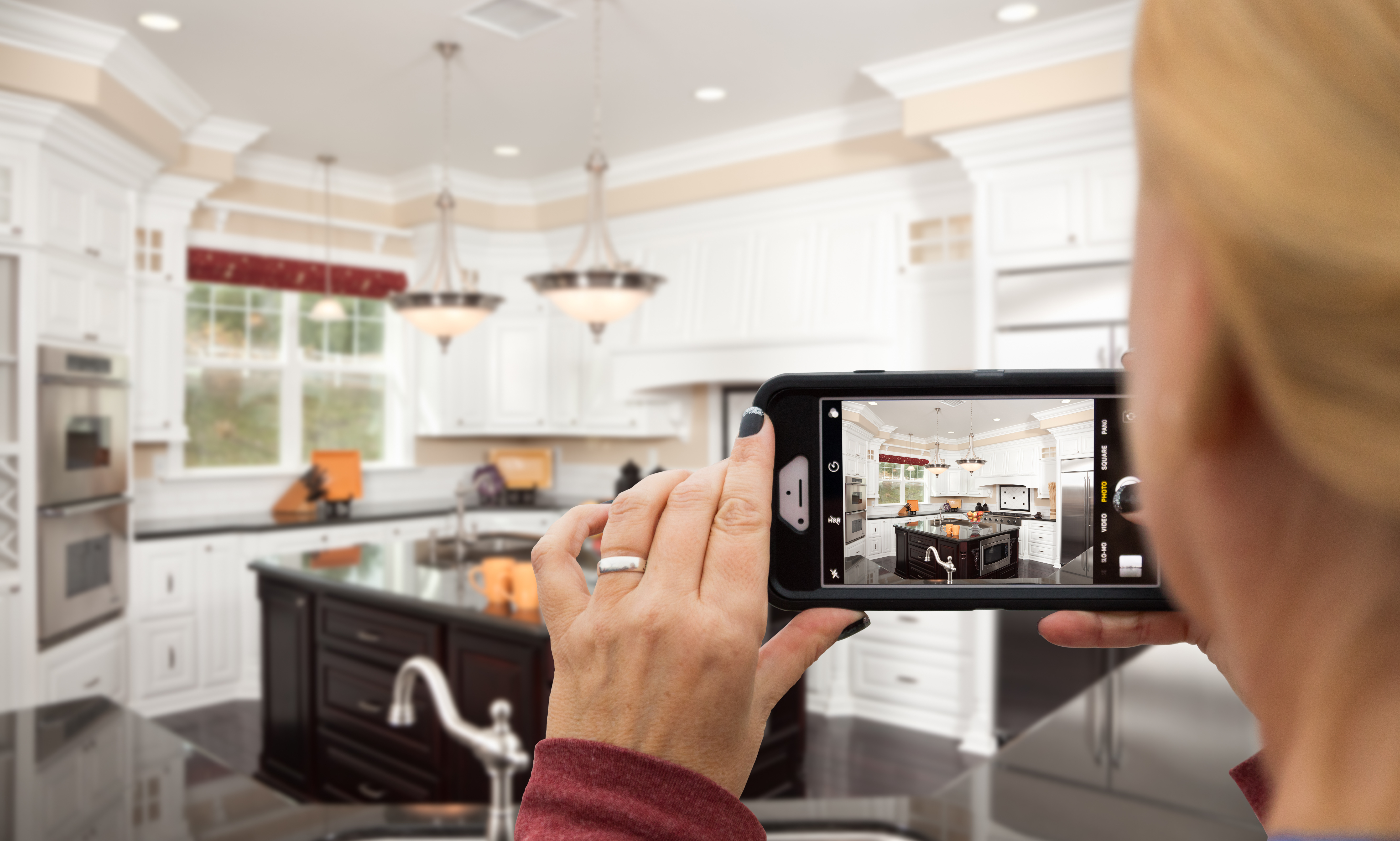 woman taking photo video of her kitchen house