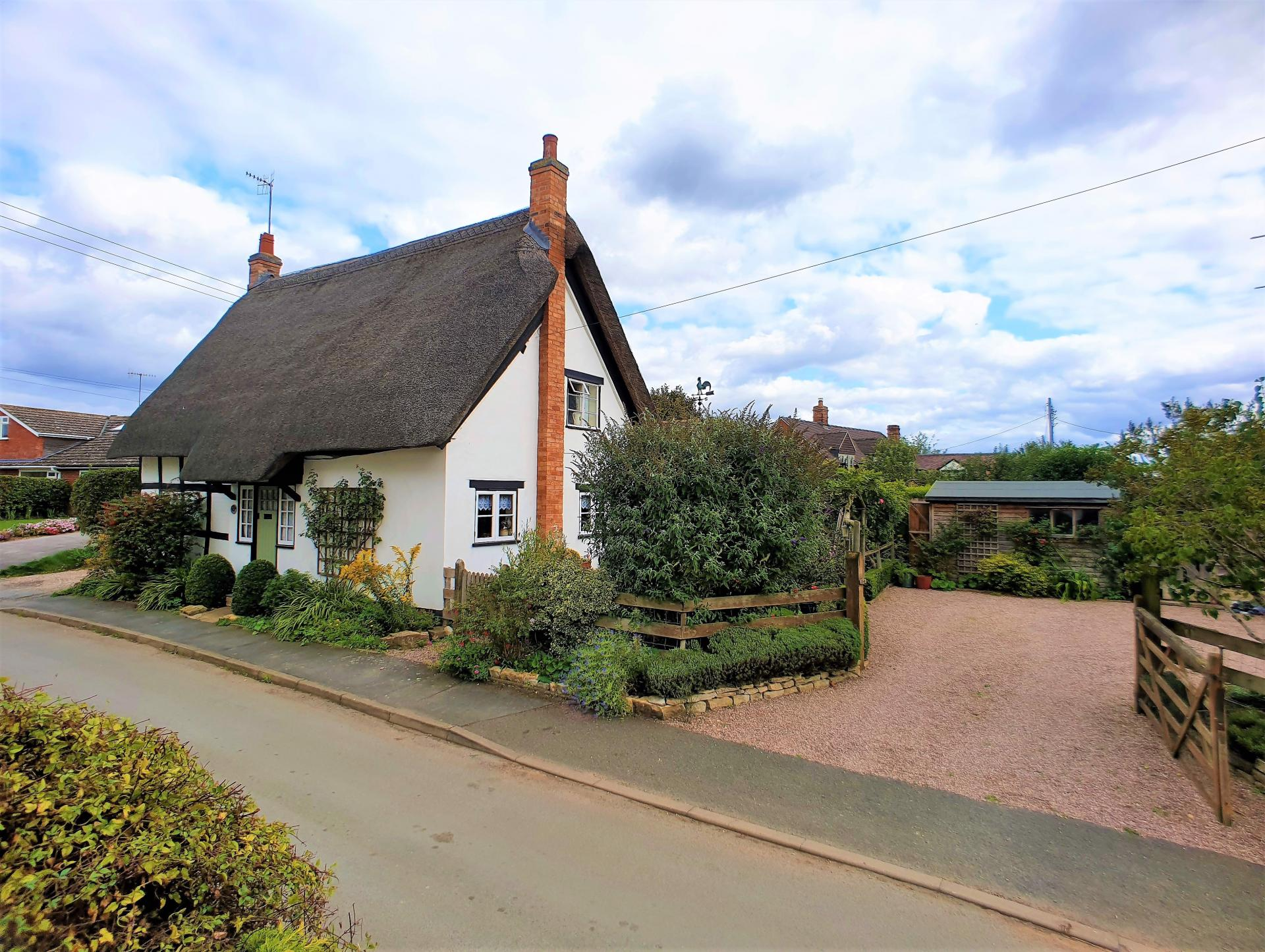 pretty english thatched cottage