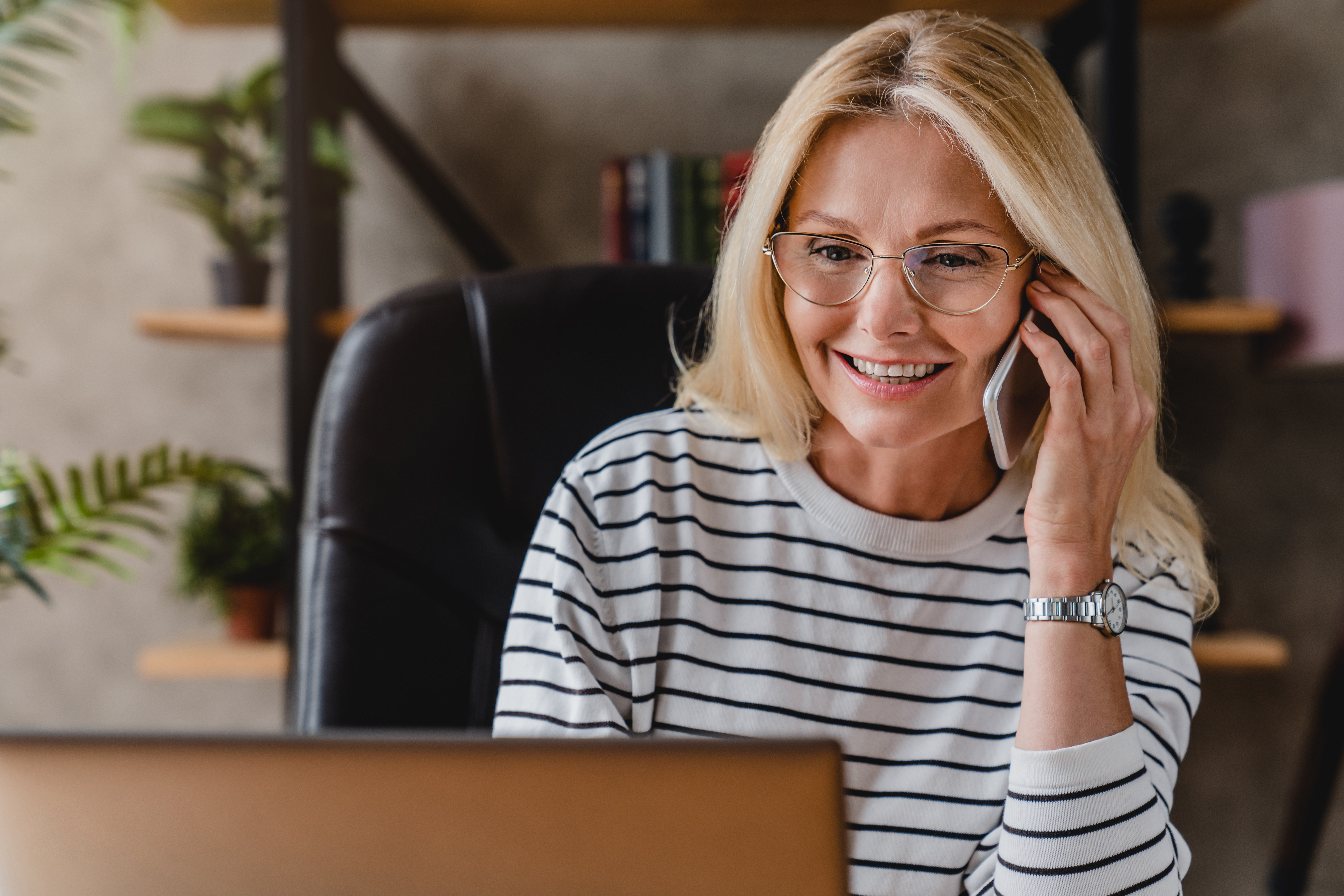 friendly woman on phone in home office