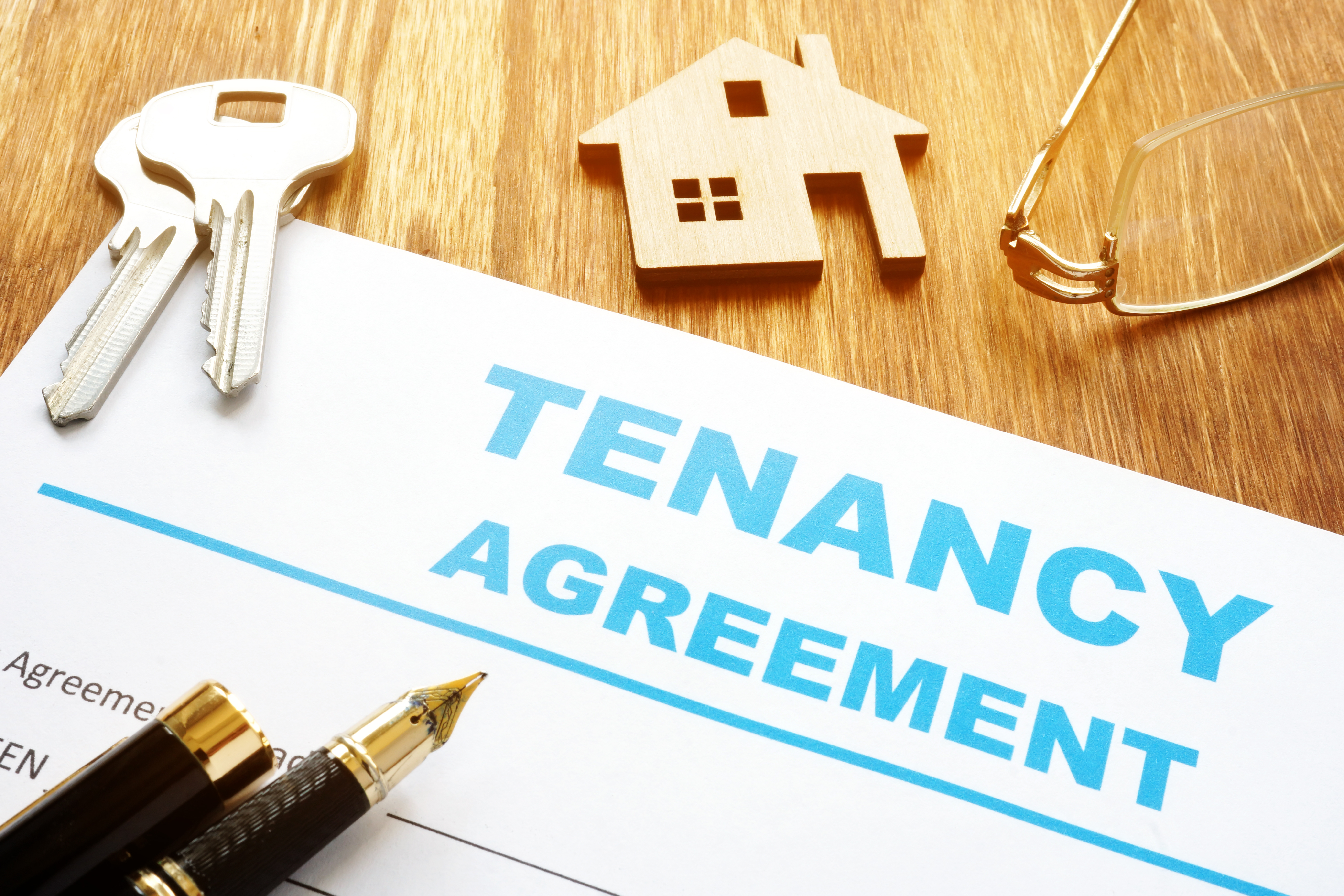 Tenancy agreement for rental lease and keys.