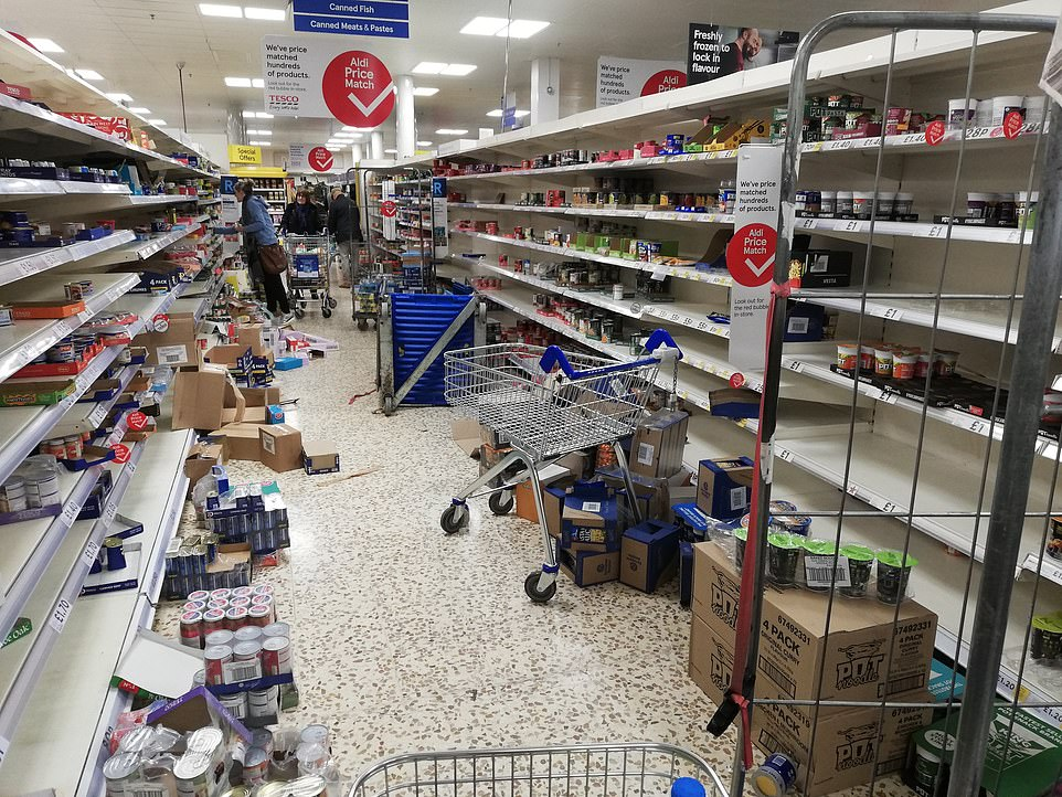 25978498-8113007-shelves_in_tesco_cleared_as_trolleys_are_piled_high_amid_coronav-a-63_1584228974283