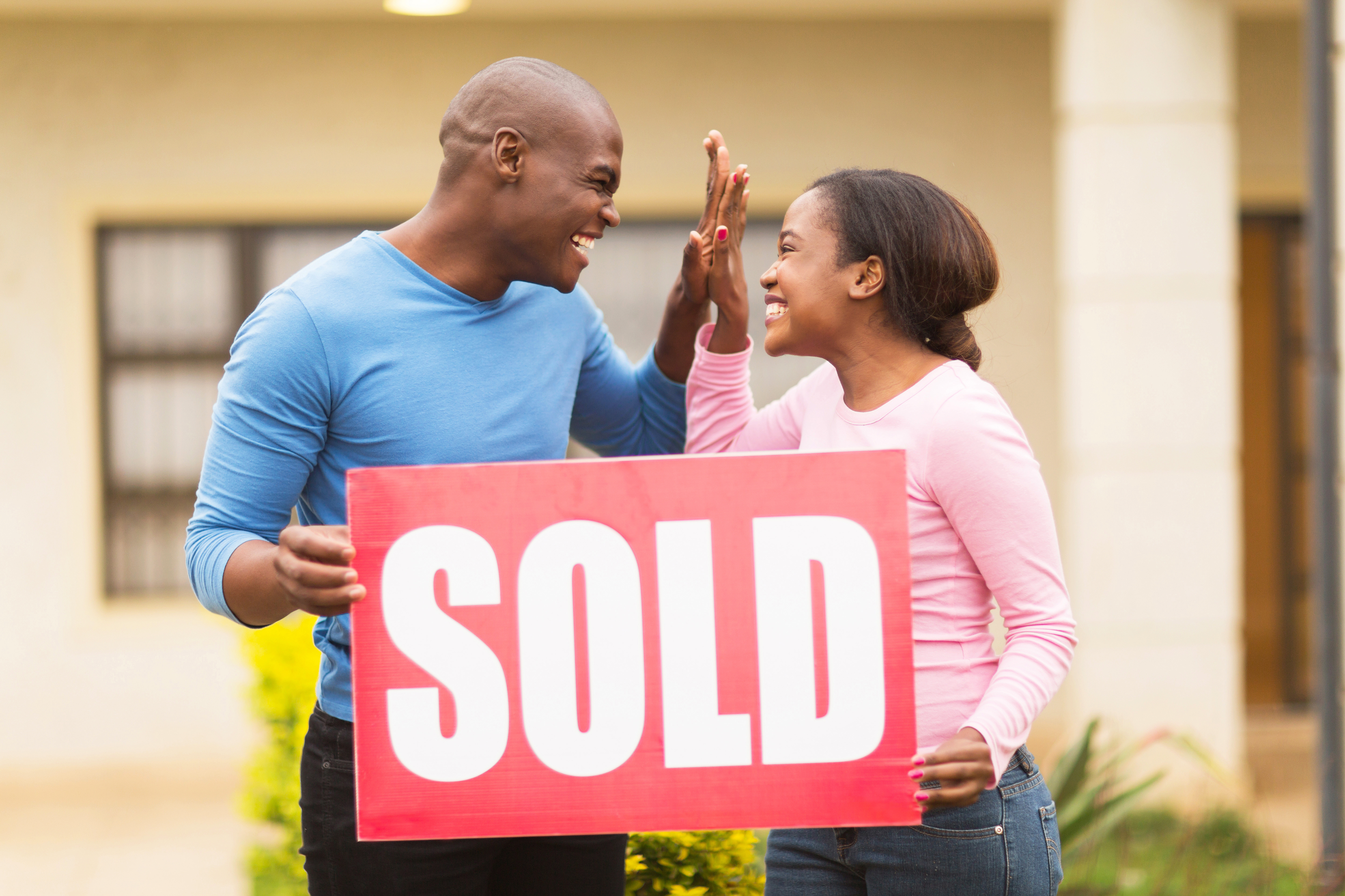 couple celebrating their house been sold