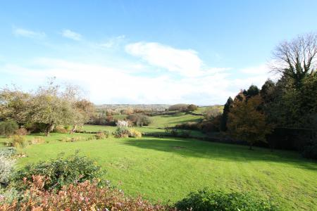 Spectacular views over open countryside from this handsome detached family residence